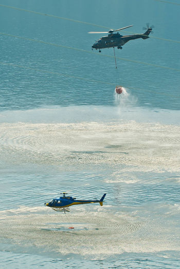 Helicopter Air Vehicle Beach Beauty In Nature Day Fire Department In Action Flying Horizon Horizon Over Water Land Mode Of Transportation Motion Nature Nautical Vessel No People Outdoors Scenics - Nature Sea Sky Transportation Water Waterfront