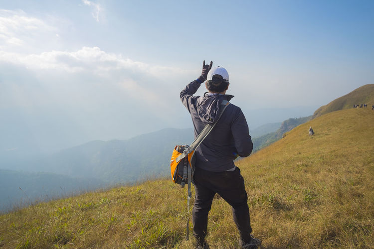 Adventure Backpack Beauty In Nature Casual Clothing Day Friendship Full Length Grass Hiker Hiking Landscape Leisure Activity Lifestyles Men Mountain Mountain Range Nature Outdoors Real People Scenics Sky Standing Togetherness Two People Walking