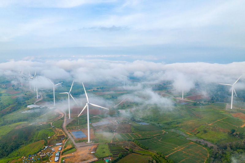 Aerial view of wind farm on field