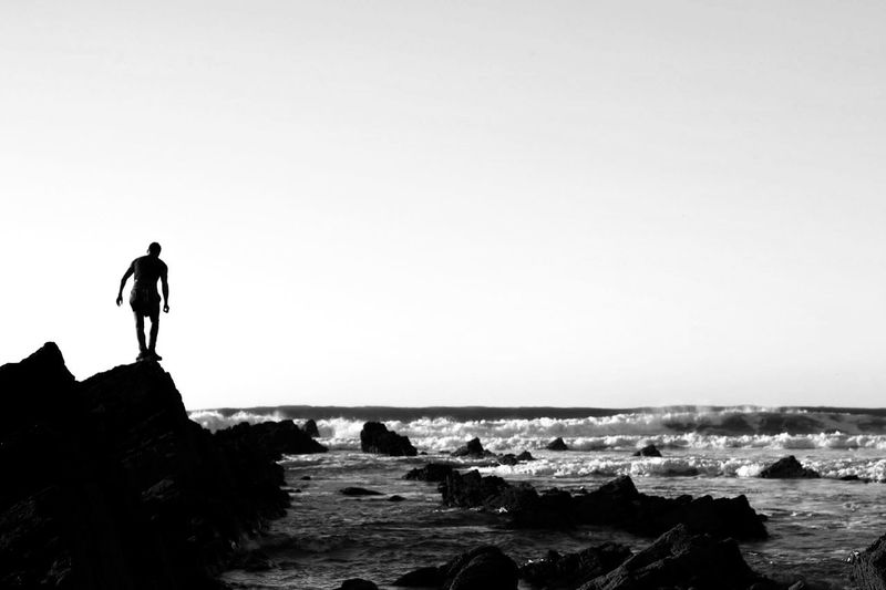 Beach Silhouette Sea Bnw_friday_eyeemchallenge Lifestyles Outdoors One Person Nature Travel Water People Beauty In Nature Real People Men Sky Day Horizon Over Water Finding New Frontiers Landscapes Beach Life Cornwall Ladyphotographerofthemonth Black And White Precarious New Horizons Lost In The Landscape