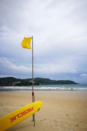 Beach Sand Cloud - Sky Water Lifeguard  Sky Beauty In Nature Yellow Taking Photo