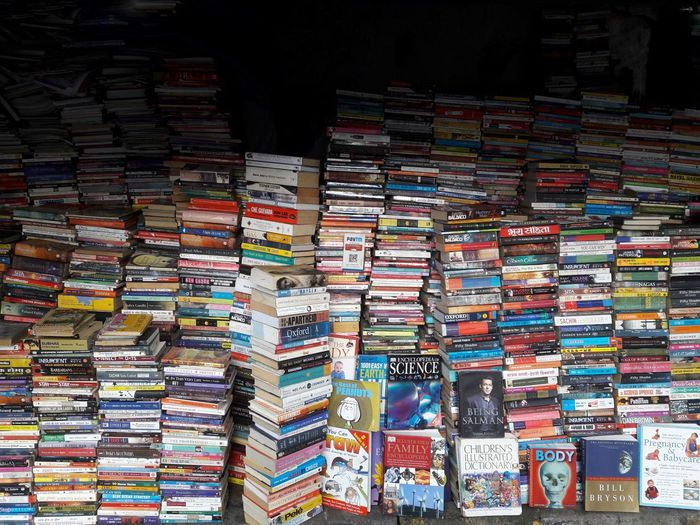 Multi colored books stacked at shop