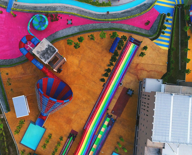 An aerial shot of colorful theme park. Day High Angle View Indoors  Multi Colored Musical Instrument No People Summer, Water, Fun, Holiday, Park, Amusement, Theme, Pool, Leisure, Vacation, Splash, Resort, Joy, Blue, Entertainment, Wet, Recreation, Outdoor, Attraction, Relaxation, Tourism, Slide, Activity, Motion, Colorful, Ride, Roller, Extreme, Aqua Park, Beautif Table