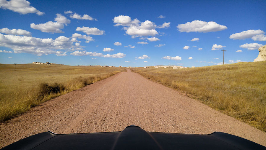 Road Cloud - Sky Sky Direction Diminishing Perspective Landscape Land The Way Forward vanishing point Personal Perspective Outdoors Gravel Gravel Road Dirt Road Back Roads Car POV Driving Exploring Clouds And Sky Wyoming Plains Prairie Grassland Scenics - Nature