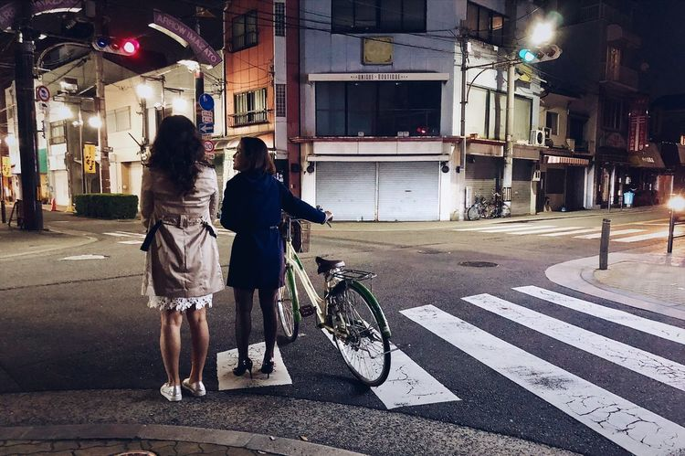 Looking for something to eat on the street at midnight and walking with women on heels with bikes. Shinimazato, Osaka, Japan April 2018 City Street Real People Road Women Architecture Crossing Crosswalk