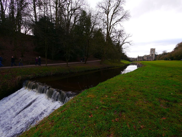 Architecture Beauty In Nature Day December December 2016 Fountains Abbey Fountains Abbey Yorkshire Fountains Abbey, Yorkshire Grass Growth Landscape Nature Outdoors Real People River Scenics Sky Tranquil Scene Tranquility Travel Destinations Tree Water