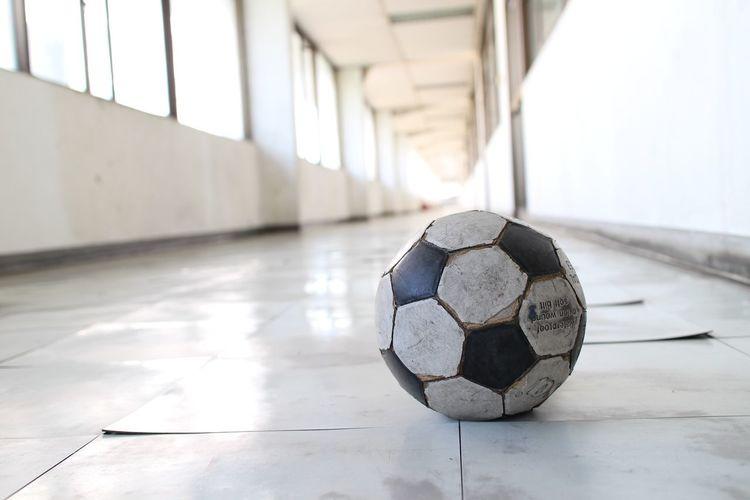 Abandoned Soccer Ball In Corridor Of Old School Building