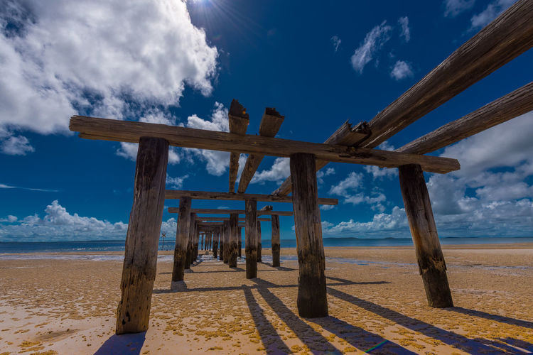 Ruins on Fraser Island Beach Beauty In Nature Blue Cloud - Sky Day Nature No People Outdoors Scenics Sea Sky Tranquil Scene Tranquility Water Wood - Material