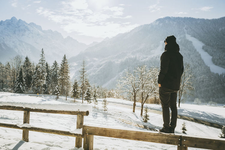 Men on mountain standing on the fence and enjoying view Freedom Nature Standing View Winter Cold Cold Temperature Enjoying Life Fence Frozen Road Jacket Looking Male Mountain Outdoors Snowy Taking Time To See The Little Things Teenager Warm Clothing Young Adult