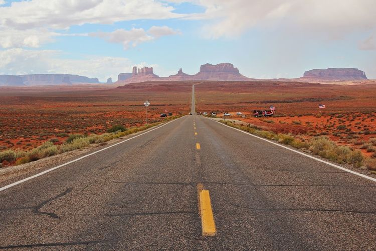 Beautiful monument valley Direction Road Sign The Way Forward Sky Transportation Symbol Marking Cloud - Sky Road Marking vanishing point Diminishing Perspective Nature Mountain No People Landscape Beauty In Nature Environment Scenics - Nature Day Outdoors Dividing Line Long
