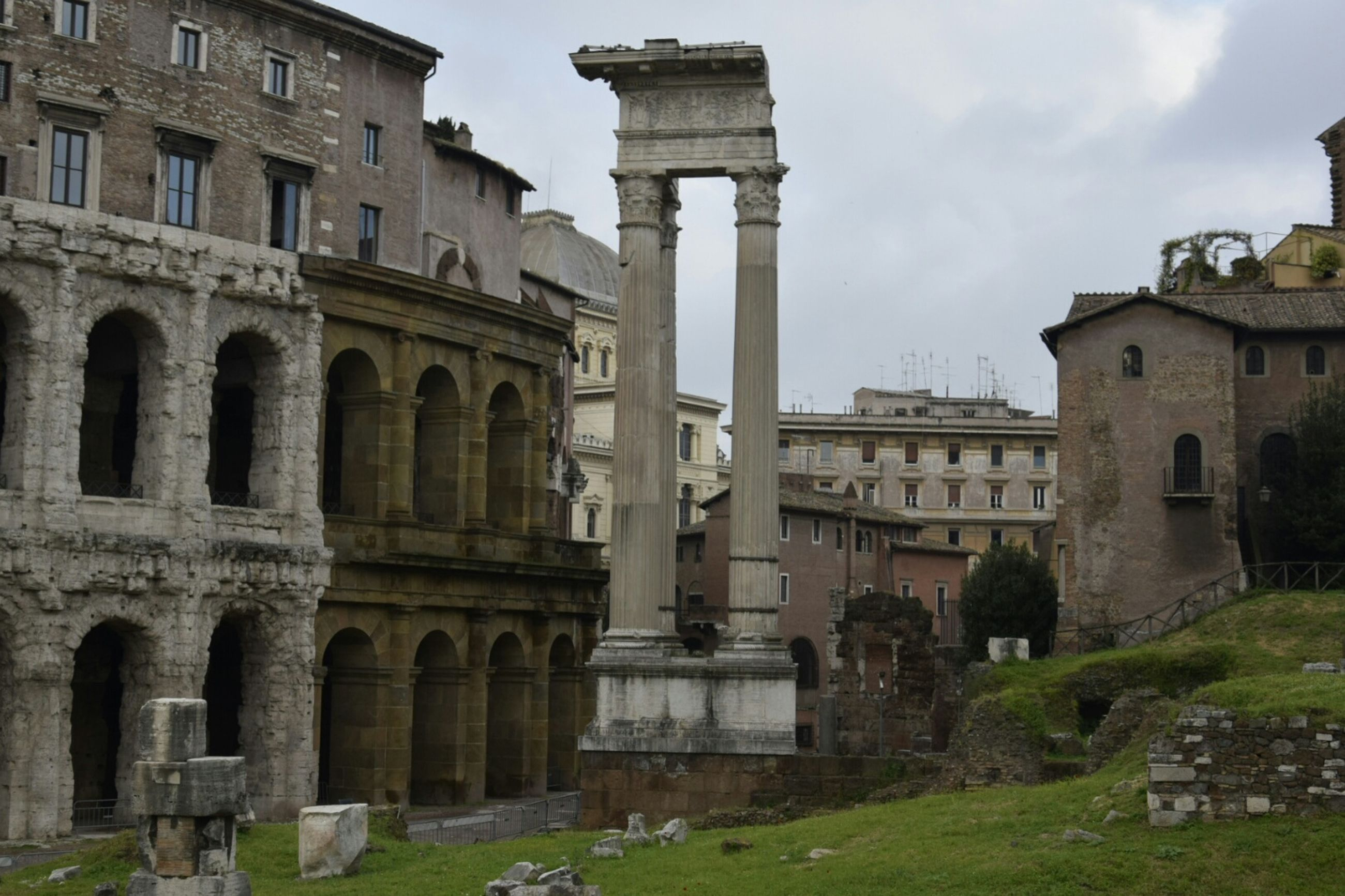 architecture, built structure, history, building exterior, old ruin, the past, ancient, old, famous place, travel destinations, ancient civilization, tourism, architectural column, travel, international landmark, arch, grass, sky, ruined, damaged