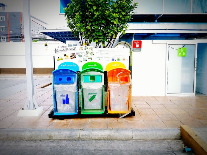 Colorful of three recycle bin or garbage on walkside in front of disabled toilet. Concept city clean, save the world and reduce material. Multi Colored Recycle Bin Garbage Bin Reuse And Recycle Cleaning Dump Waste Disposal Pollution Of The Environment Ecology Trash Recycling Materials Three Objects Walkside Dirty Discarded Environment Symbols
