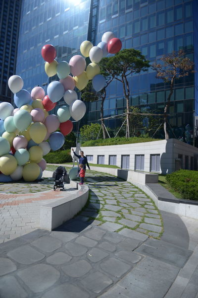 Architecture Balloon Building Building Exterior Built Structure City Day Decoration Footpath Helium Balloon Multi Colored Nature No People Outdoors Plant Residential District Street Sunlight Tree