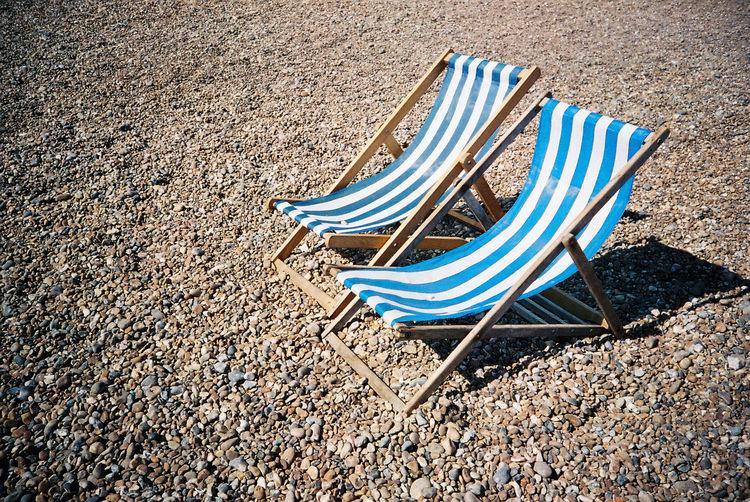 waiting for you Analogue Analogue Photography Beach Beach Chairs Blue Brighton Beach Day Empty Film Photography Filmisnotdead Happy Here I Am Holiday No People Outdoors Relaxing Moments RockBeach Sand Sunlight Sunny Kiomi Collection Two Is Better Than One