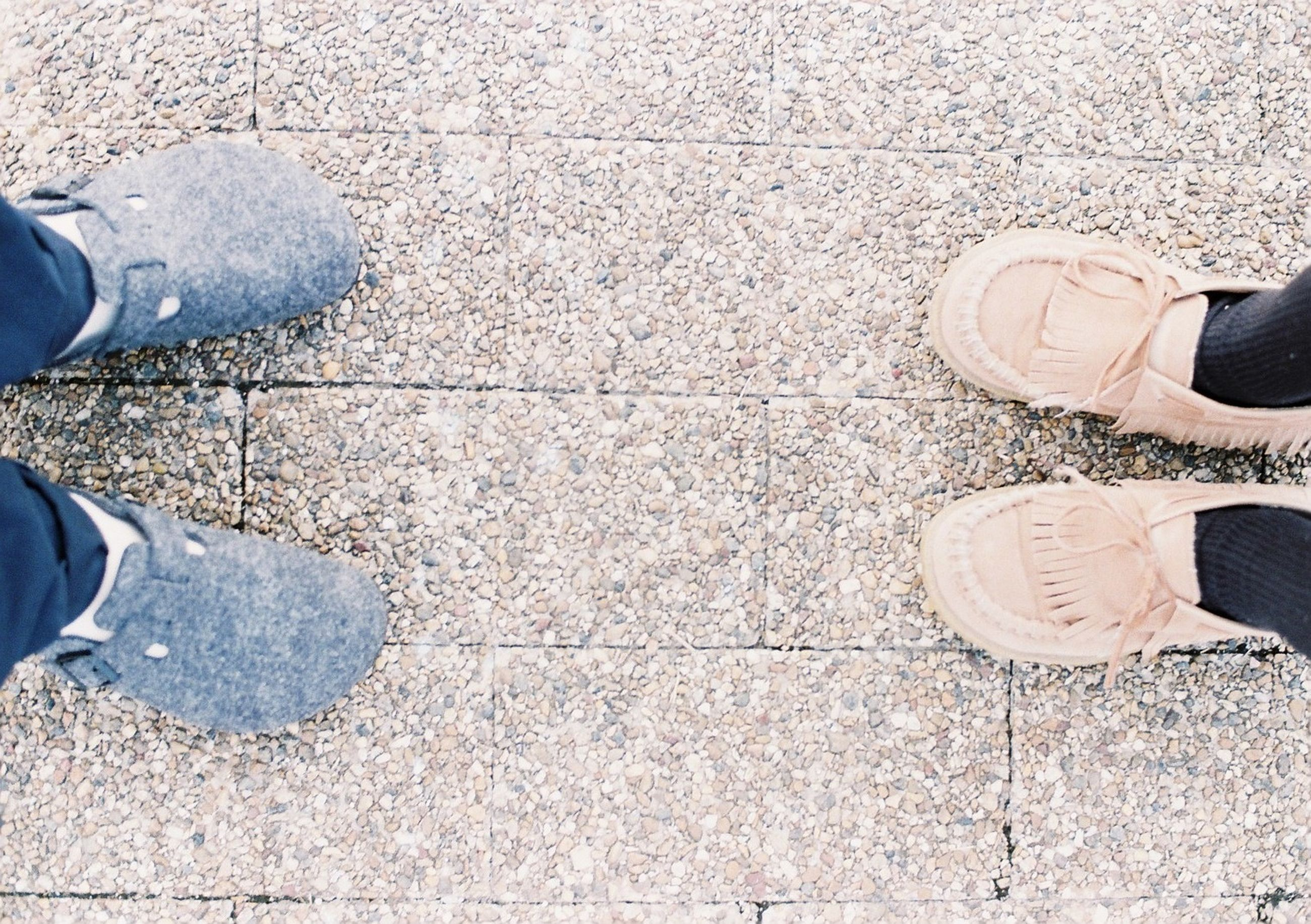 low section, person, shoe, personal perspective, footwear, human foot, standing, high angle view, lifestyles, part of, directly above, men, street, unrecognizable person, canvas shoe, leisure activity, jeans