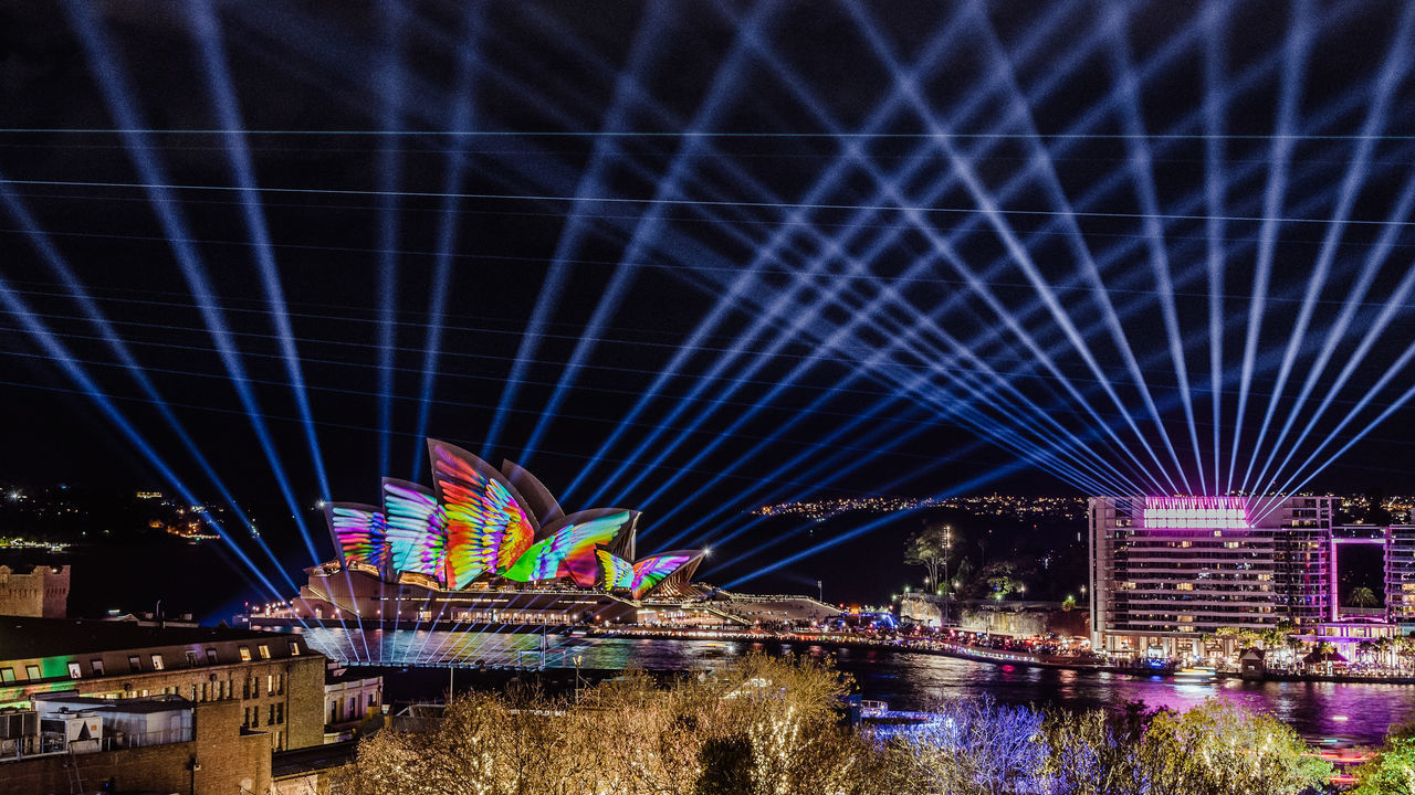 architecture, illuminated, night, built structure, building exterior, water, multi colored, city, sky, river, nature, arts culture and entertainment, no people, amusement park, waterfront, reflection, travel destinations, ferris wheel, amusement park ride, laser, nightlife