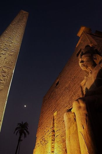 Alone Time Discovery World Egypt Statue Traveling Ancient Ancient Civilization Archaeology Architecture Building Exterior Built Structure Drark Sky Follow The Guide History Illuminated Night No People Old Ruin Outdoors Sky The Moon The Past Travel Travel Destinations Worship Places