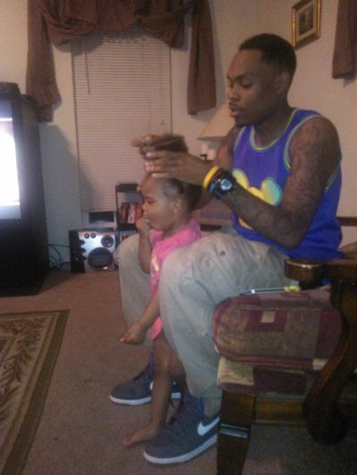 Brother Doing His Little Girls Hair