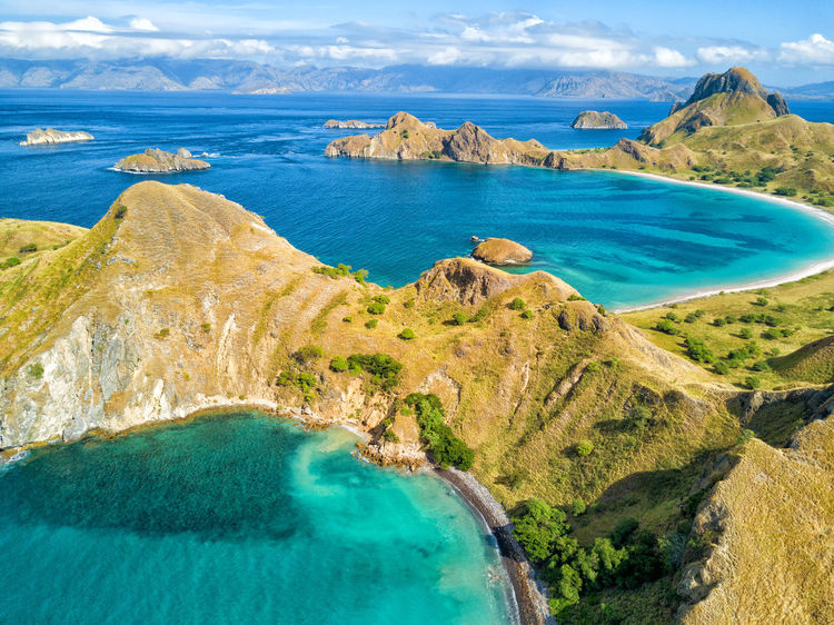 Aerial view of two aquamarine bays on Pulau Padar island in between Komodo and Rinca Islands near Labuan Bajo in Indonesia. DJI X Eyeem DJI Mavic Pro Dragon Flores Island INDONESIA National Park Tourist Travel Travel Photography Aerial Aerial Photography Aerial View Destination Dji East Nusa Tenggara Flores Komodo Labuan Bajo Landscape Padar Pulau Rinca Tourism Tropical Vacation