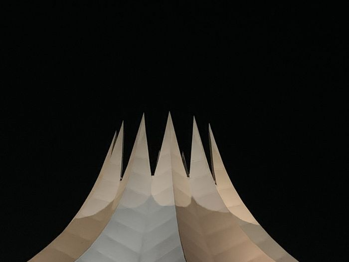 Low angle view of structure against sky at night