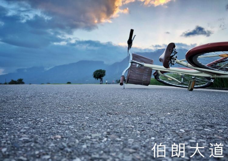 伯朗大道 Sunset 伯朗大道 Bicycle Sky Cloud - Sky Nature Transportation Day Road Outdoors Water Mode Of Transportation No People City Leisure Activity Surface Level Street Lifestyles Land