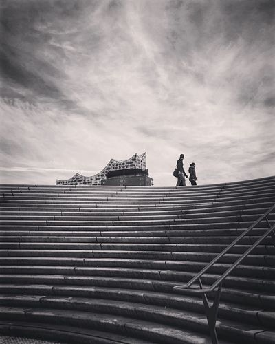 Steps Steps And Staircases Built Structure Real People Architecture Sky Day Two People Cloud - Sky Outdoors Lifestyles Building Exterior Streetphotography Travel City Hamburg Monochrome Bnw Black & White Blackandwhite Photography Black And White Architecture Elbphilharmonie Modern Architecture Travel Destinations