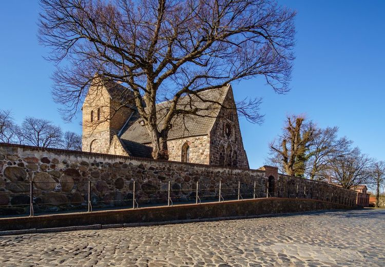 Blue Sky Community Urban Wall Bricks Village Streetphotography Brandenburg Germany History Church History Architecture Outdoors Clear Sky Built Structure No People Sky Tree Day