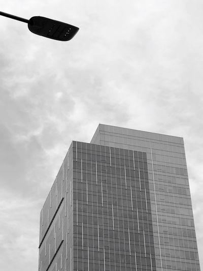 Sky Low Angle View Building Exterior Architecture Built Structure Cloud - Sky Day Outdoors No People City Building Buildings Buildings & Sky Building And Sky Grey Sky Grey Building Grey Day Workplace Welcome To Black