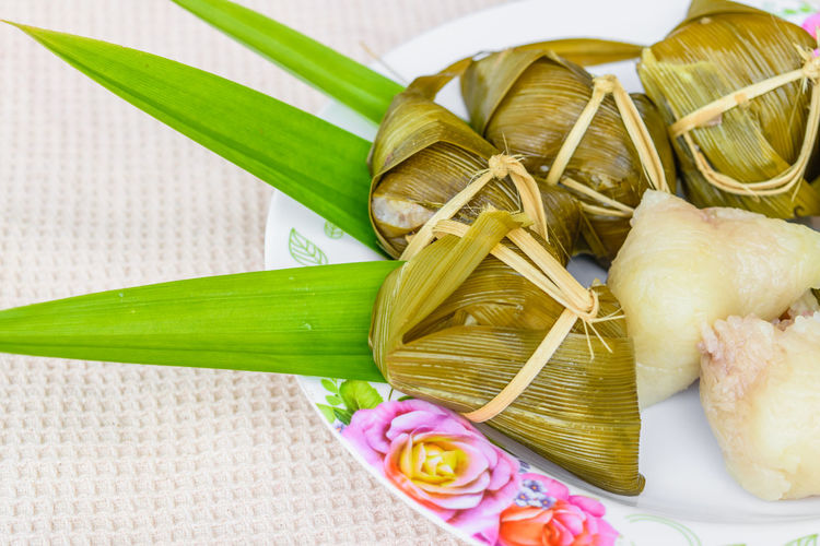 Traditional Thai food style, Thai dessert made from banana and glutinous rice, wrap with pandan (Khao Tom Mat) Close-up Food Food And Drink Freshness Green Color Healthy Eating High Angle View Indoors  Leaf Leaves Nature No People Plant Plant Part Still Life Table Vegetable Wellbeing