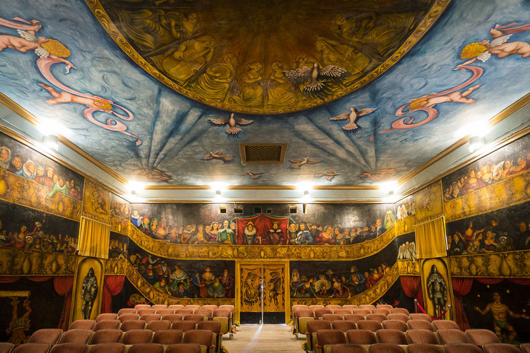 Old opera house Absence Architecture Art And Craft Belief Built Structure Ceiling Craft Creativity Floral Pattern Fresco Human Representation Illuminated Indoors  Lighting Equipment Mural No People Ornate Place Of Worship Religion Representation Seat Spirituality Travel Destinations