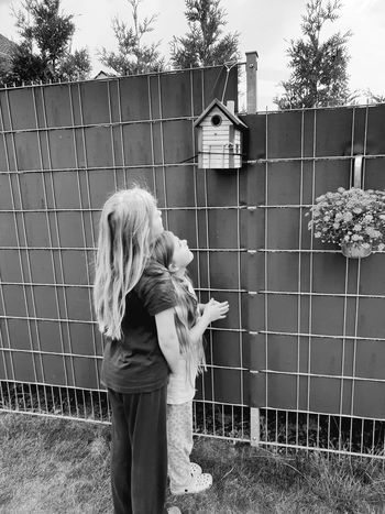 My Daughters ❤️ Girls Blackandwhite Blach And White Kids Daughters Hair Long Hair Lo9k Birdhouse Listen To The Chirping Of The Birds Garden Our Garden Nice Beautiful Beautiful Nature Nice Prison Confined Space Child Trapped Oil Pump Childhood Cage Girls Elementary Age
