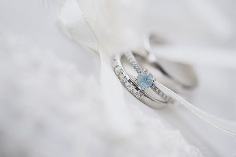 Close-up of wedding rings with textile