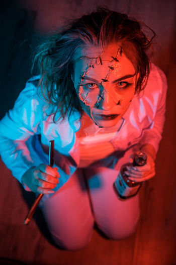 "The character from the movie ""Mr. Stitch."" Young woman in makeup. The face of skin patches and scars with stitches. Art project. Studio photography on a black background. Photos with color filters. Red and blue tones. Mood: depression, sadness. Madness. Unretouched Photography Unretouched Candid Authentic Lifestyles Lifestyle One Person One Woman Only One Young Woman Only Only Women Only Girls Woman Woman Portrait Portrait Portrait Of A Woman Madness Depression - Sadness Depression Sadness Red Red Color Filter Blue Black Background People People Watching People Photography people and places Color Colors Colorful Real People High Angle View Holding Indoors  Young Adult Leisure Activity Front View Arts Culture And Entertainment Young Women Three Quarter Length Focus On Foreground Looking At Camera Looking Casual Clothing Costume"
