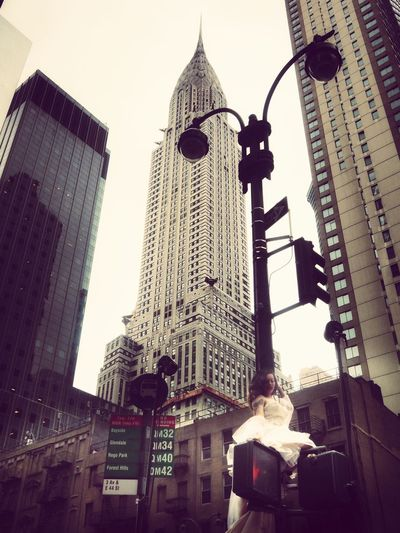 The bride in the big city Tower New York City Crysler Building Bride Architecture Built Structure Building Exterior Low Angle View Building City Tall - High Skyscraper Sky Outdoors Place Of Worship