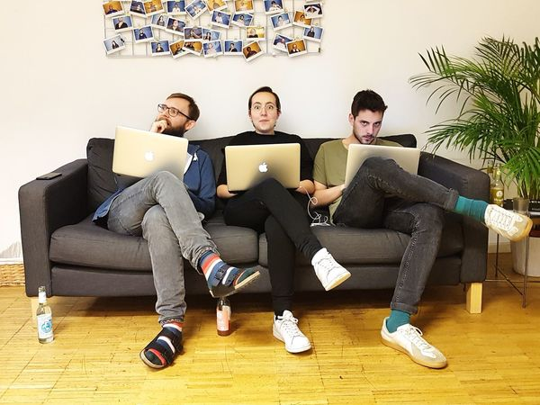 Thank god it's Friday! EyeEm Team Couch Sitting Laptop Wireless Technology Technology Only Men Young Adult Young Men Using Laptop Communication Internet Sitting Connection Computer Colleague