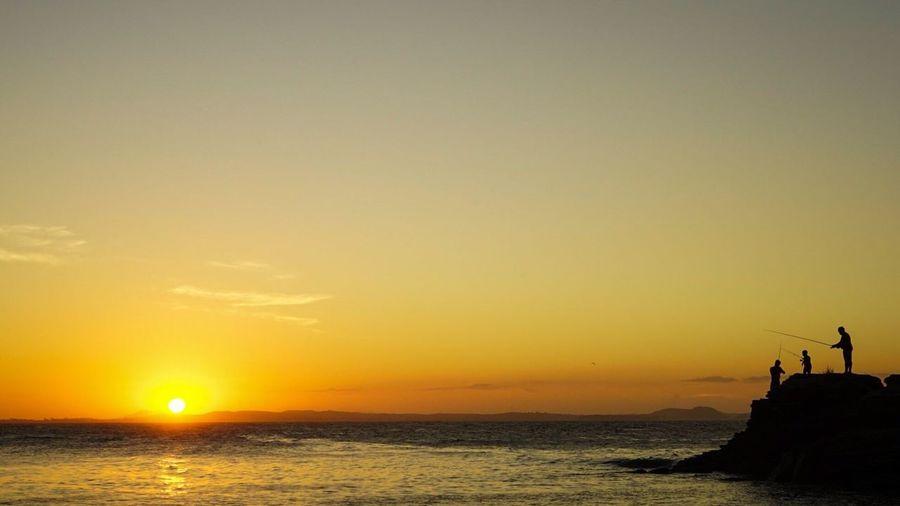 Fishing during sunset Seaview Dramatic Sky Sea Sky Moody Sky Praia Buzios Sunset Beach Fishing