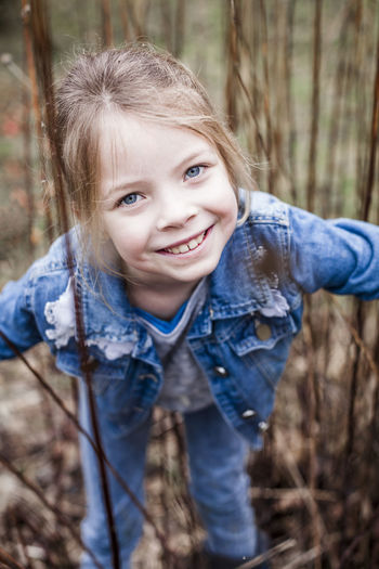 beautiful girl posing outdoor Cheerful Childhood Close-up Cute Day Forest Girls Happiness Looking At Camera Nature One Person Outdoors People Portrait Real People Smiling Tree