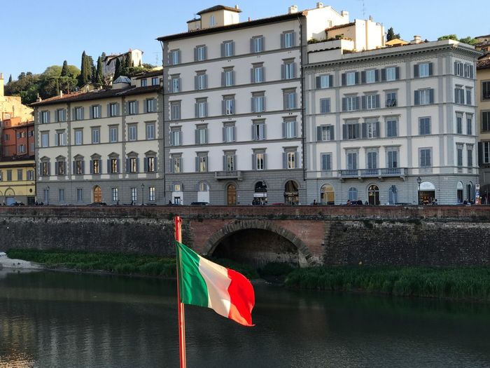 Florence Italy River Architecture Flag Building Exterior Built Structure Patriotism Water Day Outdoors Waterfront No People Sky City Turism Your Ticket To Europe