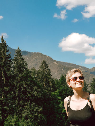 Portrait of woman in sunglasses against sky