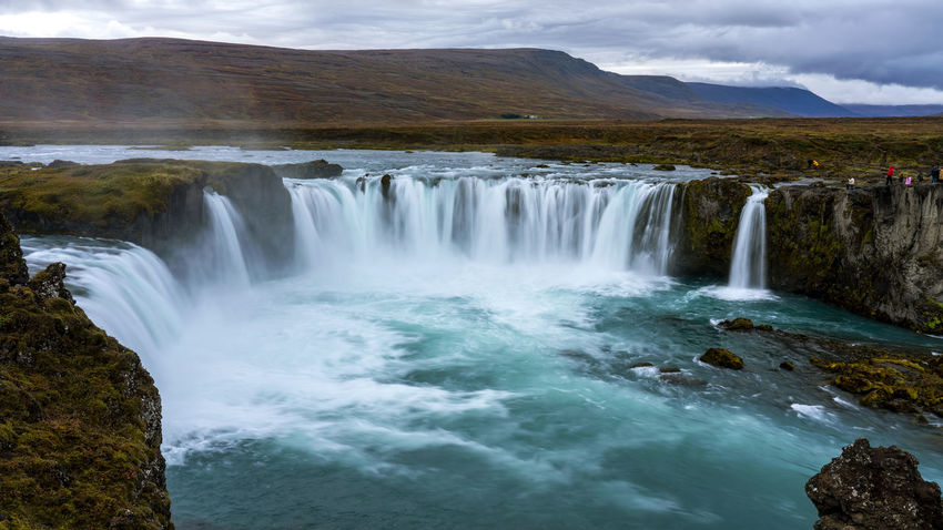 The Goðafoss is a waterfall in Iceland. It is located in the Bárðardalur district of Northeastern Region at the beginning of the Sprengisandur highland road. The water of the river Skjálfandafljót falls from a height of 12 meters over a width of 30 meters. Scenics - Nature Water Beauty In Nature Waterfall Motion Long Exposure Nature Flowing Water No People Outdoors Power In Nature Flowing Goðafoss Waterfall Sunrise Sunset Environment Blurred Motion Majestic Beauty In Nature Horseshoe Falls Rocks Land Mountain Non-urban Scene Cloud - Sky Day Sky Travel Destinations Power