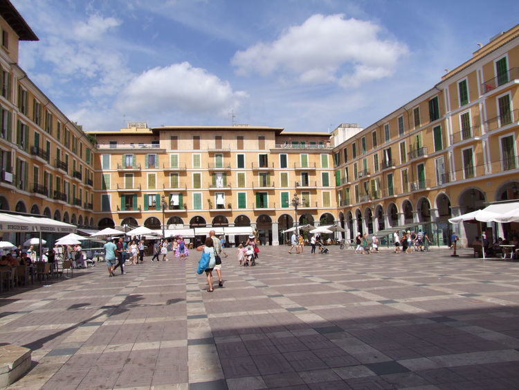 Placa Major, Palma Blue Sky White Clouds City Composition Food And Drink Low Angle View Mallorca Palma Palma De Mallorca Restaurants SPAIN Square Sunlight And Shade Architecture Building Exterior Built Structure Capital Full Frame Incidental People Outdoor Photography Outside Restaurant Placa Major Tour Attraction Tourism Travel Destination Umbrellas