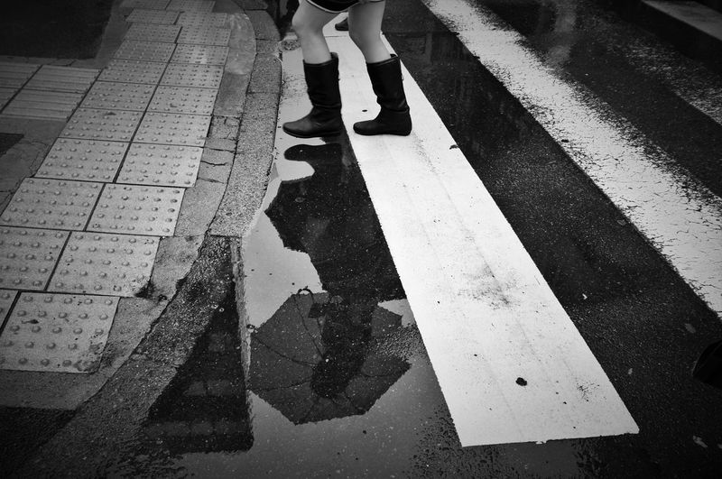 Low Section Of Woman On Wet Street