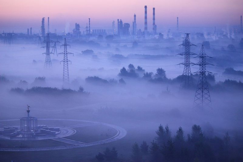 Aerial View Of Landscape Against Sky During Foggy Weather