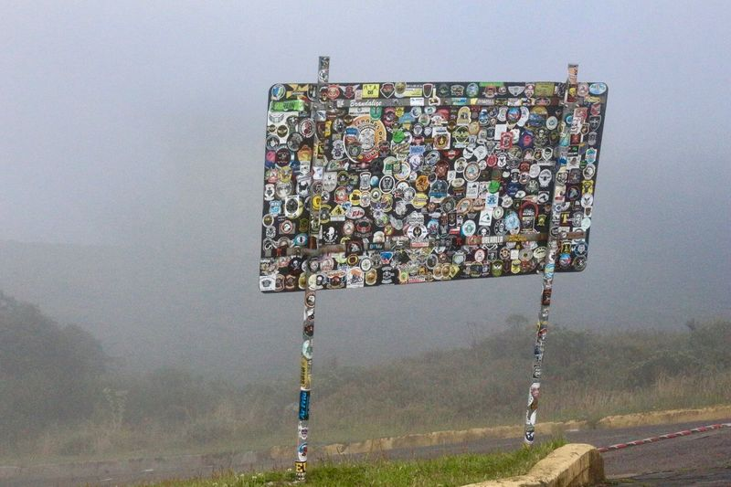 After motorcyclist visit on the mountain... Decals Foggy Fogo Day Hovering Landscape Motorcycle Decal Mountain Nature No People Outdoors Signboard Sky Miles Away