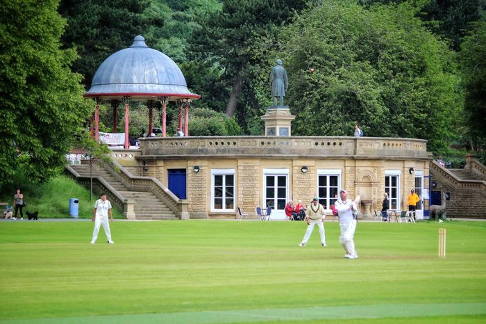 Cricket Field Grass Playing Tree Sport Cricket! West Yorkshire Saltaire Cricket Bradford Westyorkshire Green Color Men Leisure Activity Togetherness Adults Only Outdoors Adult Lifestyles Building Exterior Day Sportsman People Nature