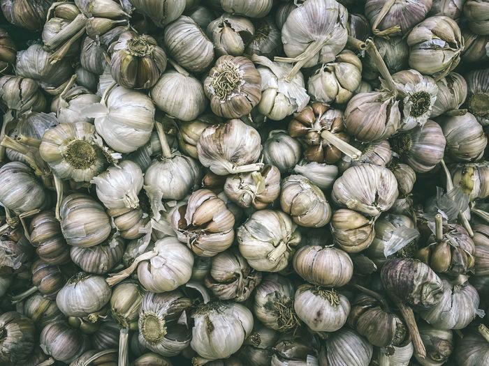Full frame shot of garlic for sale at market