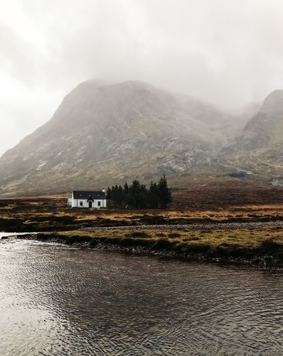 Mountain Water Beauty In Nature Sky Nature Day Scenics - Nature No People Environment Landscape Built Structure Tranquil Scene Architecture Fog Outdoors Wilderness Mountain Peak Mountain Range Scotland Glencoe Highlands Highlands Of Scotland