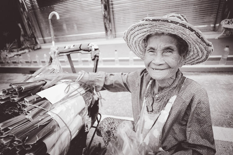 Single women Single mom Single grandmother. life from Thailand street Chinese market ,Chonburi. คุณยายขายขนมใบจากในตลาดจีนชลบุรี ^_^ Sweets wrapped from leaves International Women's Day 2019 Lifestyles Old Women Single Desserts Sweet Thailand Thai Asian  Food Snack Market Leaves Wrapped Chinese Market Stall Chonburi ,Thailand Hanging Out Senior Adult Hat Senior Women One Person Clothing Adult Portrait Real People Smiling Wrinkled Transportation Day Mode Of Transportation Casual Clothing Retirement Land Vehicle