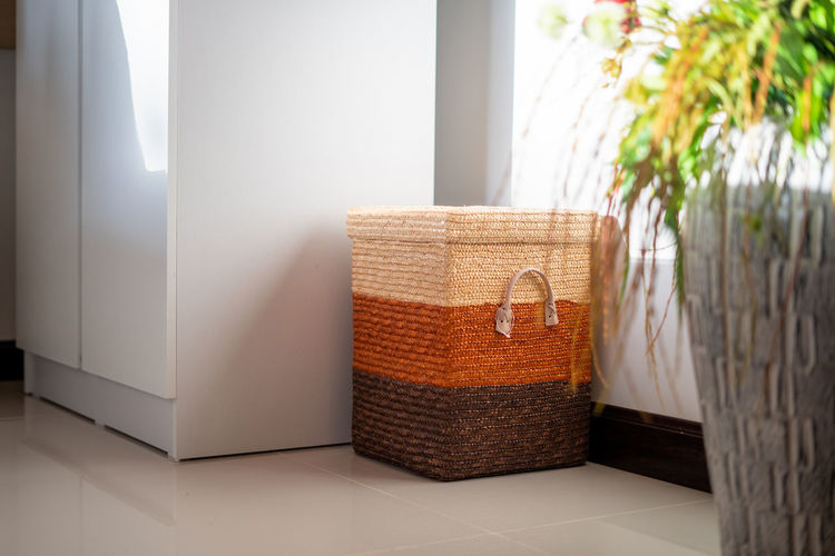 Wicker basket on wall at home