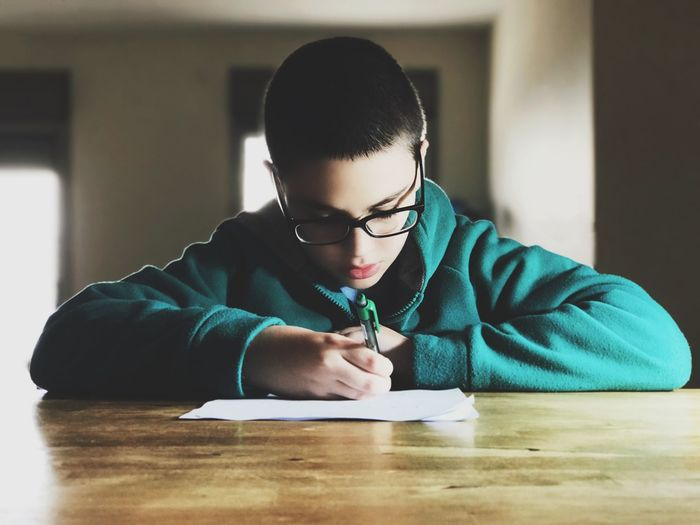 Boy Doing Homework At Home